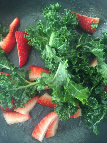 image of strawberries and kale in skillet