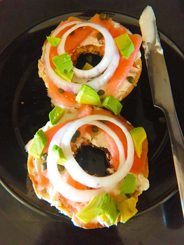 toasted everything bagels with lox, red onions, green capers