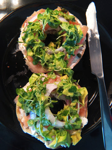 picture of lox bagels with arugula cannabis olive mix garnish