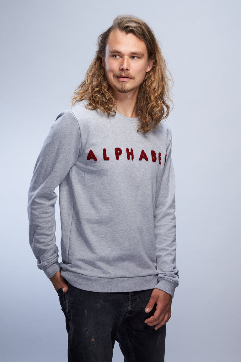 Man in grey Alphabet Phonétique sweater from SIERRA18 collection left view