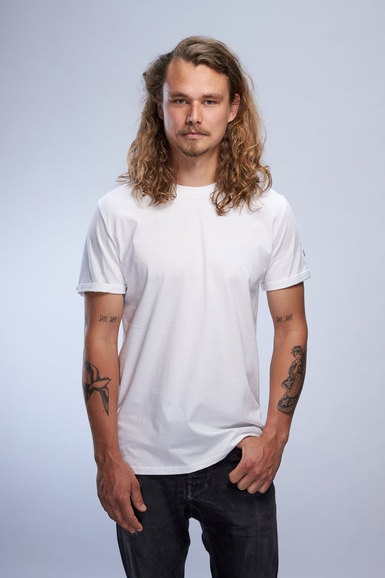 man wearing white Alphabet Phonétique wallflower t-shirt from the SIERRA18 collection front view