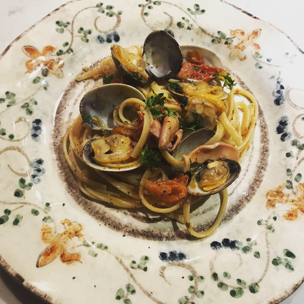 Linguine pasta with clams, squid, and cherry tomatoes