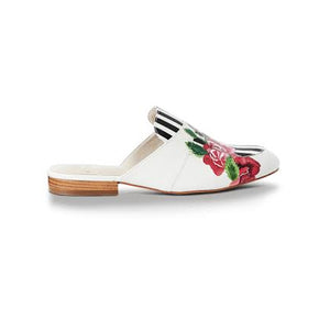 Hand-painted white slippers or mules with striking black line detail and rose motif.