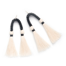 Load image into Gallery viewer, Black statement earrings with two hanging cotton tassels made from recycled cotton