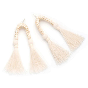 White statement earrings with two hanging cotton tassels made from recycled cotton