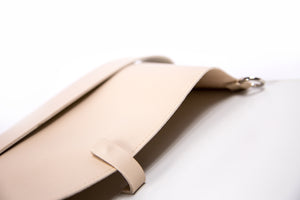 Beige vegan leather clutch with detachable shoulder strap