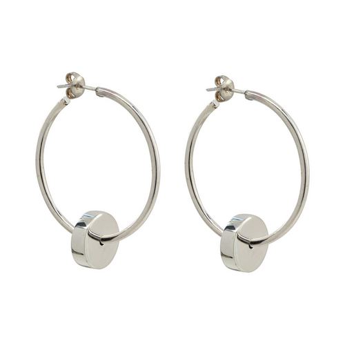 Handcrafted delicate hoop earrings in sterling silver with round disc detail at bottom of hoop