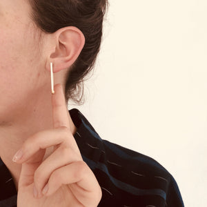 Handcrafted earrings in sterling silver made to look like a vertical matchstick