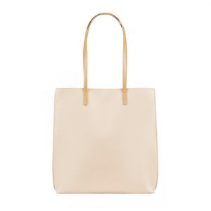 Beige vegan leather tote bag with Grey colored lining and one internal pocket.