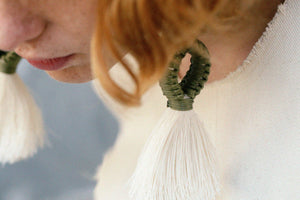 Handmade earrings with olive loop and white tassel detail made from recycled cotton