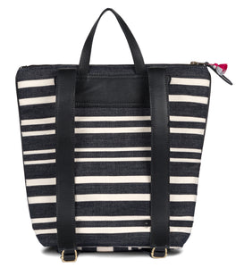 Black and white striped backpack with an exterior zip pocket. Lightly cushioned leather straps, top zipper, and interior welt pocket.