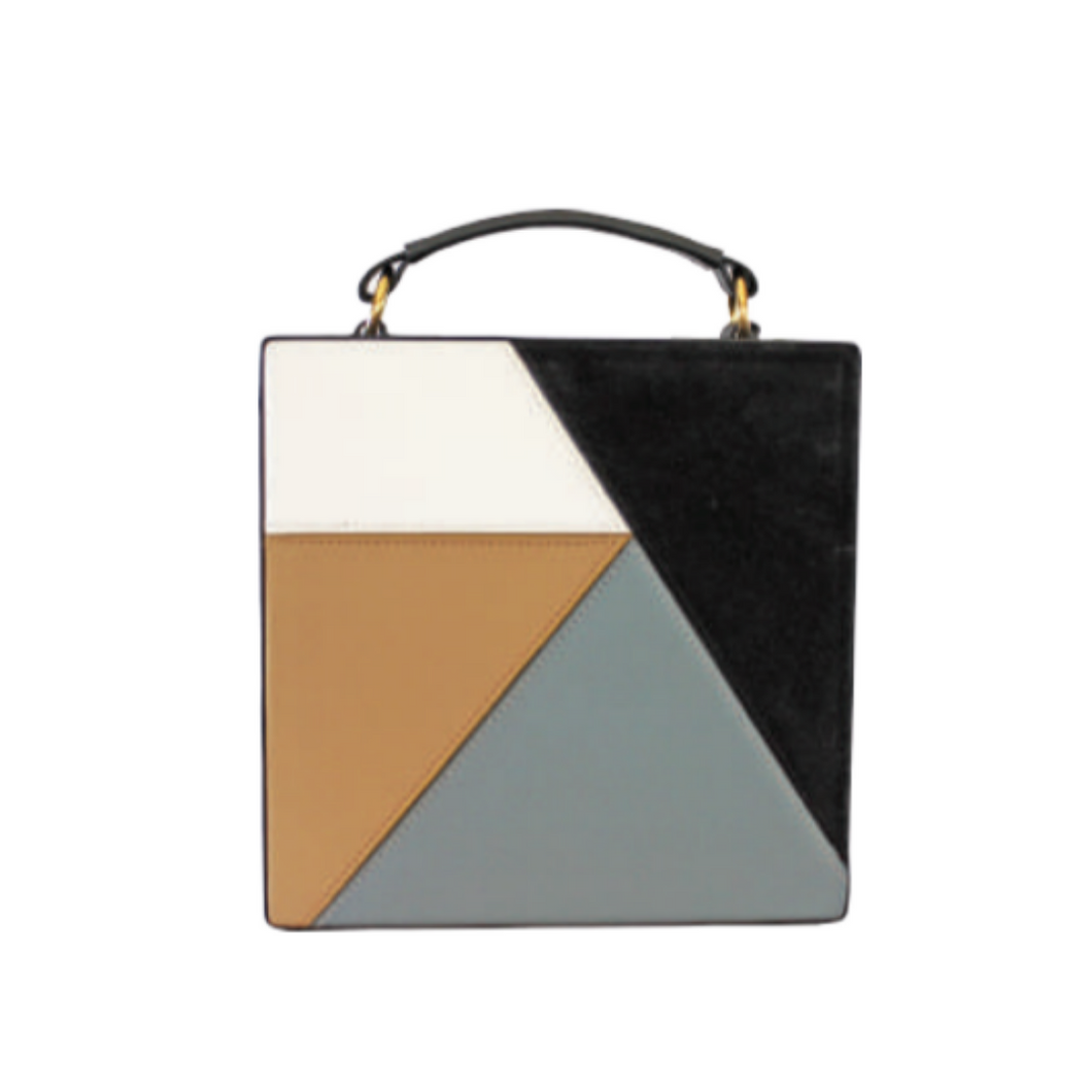 Bold, versatile square handbag with internal suede lining with external handle attachments. Crafted from grained leather with overlapping figures. Single adjustable shoulder strap.
