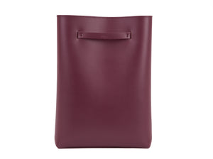 Violet vegan leather minimalist rectangular backpack, with internal pocket, and adaptable shoulder straps.