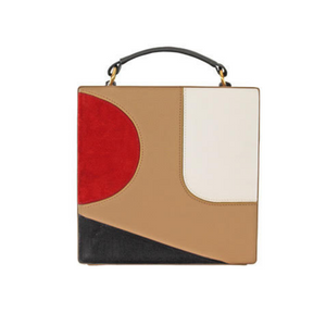 Square shaped handbag with internal suede lining and external handle attachments. Crafted from grained leather with overlapping figures. Single adjustable shoulder strap.