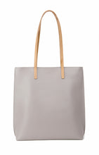 Load image into Gallery viewer, Grey vegan leather tote bag with beige colored lining and one internal pocket.