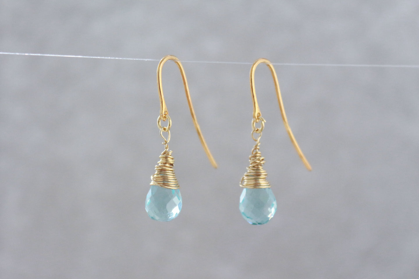 Blue_topaz_teardrop_dangle_earrings