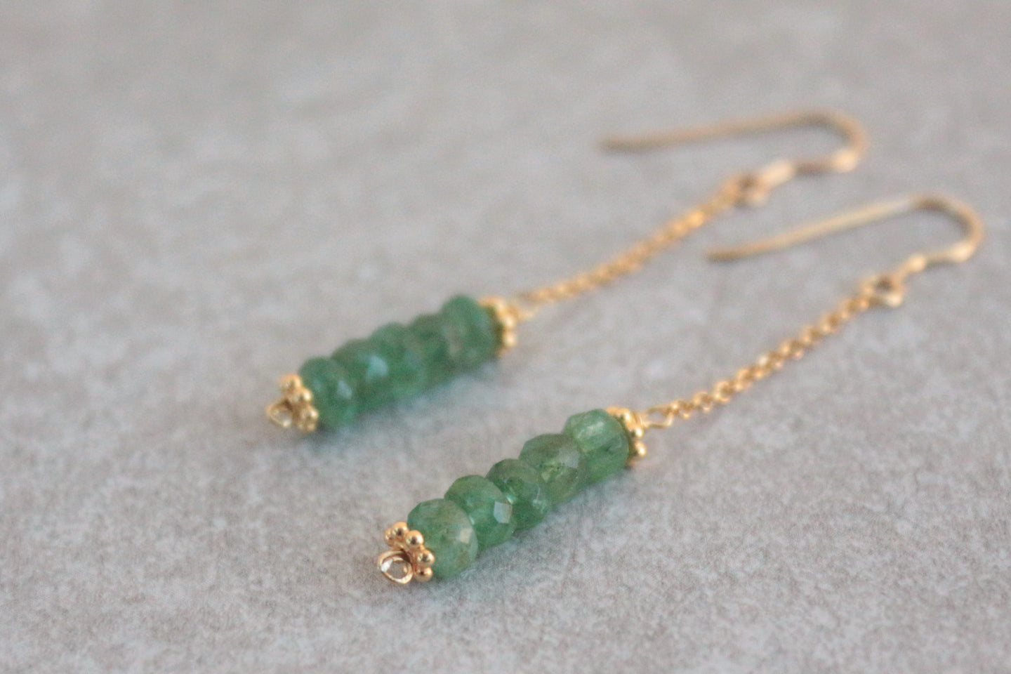 Long_line_emerald_earrings_silver_gold
