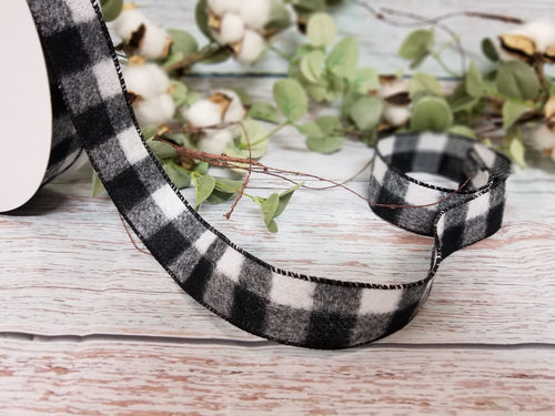 1.5 inch wide black and white buffalo plaid wired ribbon. Buffalo check wired ribbon. Use in wreaths, garlands, bows, swags, and home decor. Designer DIY carries ribbon, mesh, signs, home decor and other craft supplies.