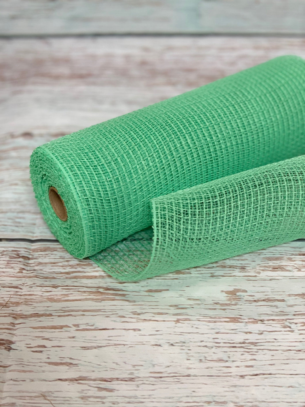 10 inch mint Fabric Mesh. Pastel mesh. Sea foam green mesh.  Designer DIY offers metallic mesh, jute mesh, burlap mesh, fabric mesh, poly mesh. Perfect for a wreath, garland, swag, etc.