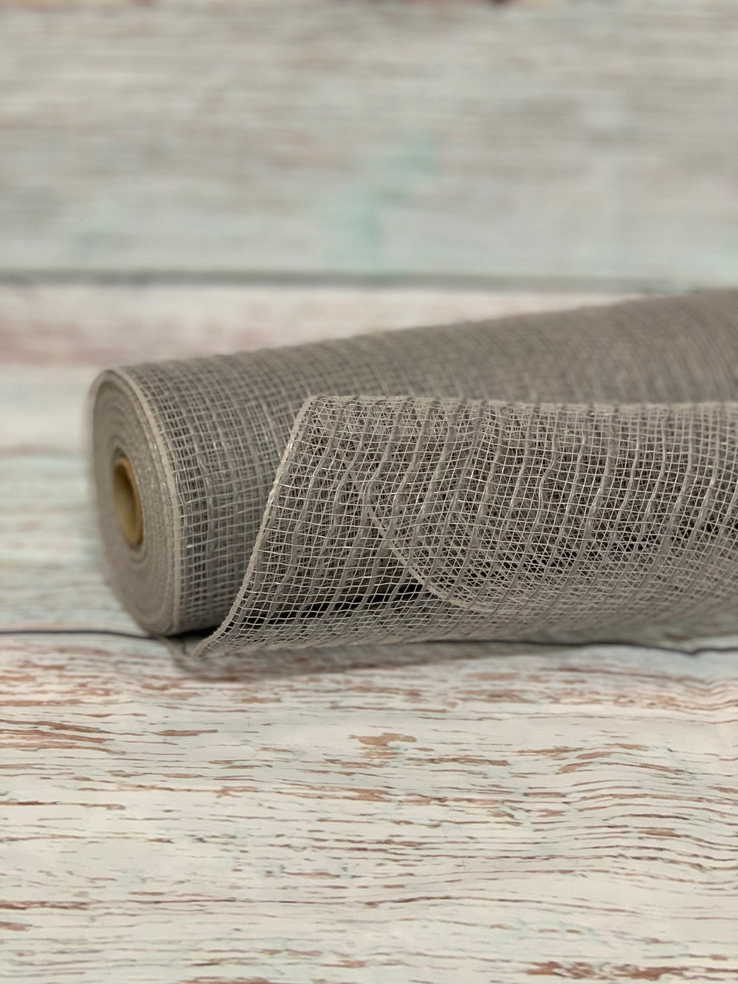 10 inch gray jute mesh. Grey mesh.  Designer DIY offers metallic mesh, jute mesh, burlap mesh, fabric mesh, poly mesh. Perfect for a wreath, garland, swag, etc.