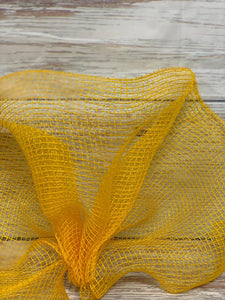10 inch Yellow gold fabric mesh. Yellow mesh. Sunflower wreath mesh. Designer DIY offers metallic mesh, jute mesh, burlap mesh, fabric mesh, poly mesh. Perfect for a wreath, garland, swag, etc.