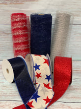 Load image into Gallery viewer, Patriotic mesh and ribbon. Star ribbon. Red Ivory and Navy Blue. 10 inch red metallic mesh with silver metallic tinsel stripe. Christmas mesh, patriotic 4th of July mesh. Designer DIY offers metallic mesh, jute mesh, burlap mesh, fabric mesh, poly mesh. Perfect for a wreath, garland, swag, etc.
