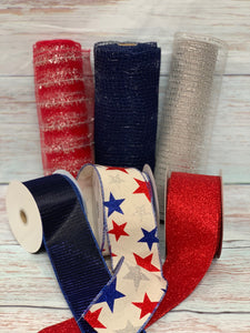 Patriotic mesh and ribbon. Star ribbon. Red Ivory and Navy Blue. 10 inch red metallic mesh with silver metallic tinsel stripe. Christmas mesh, patriotic 4th of July mesh. Designer DIY offers metallic mesh, jute mesh, burlap mesh, fabric mesh, poly mesh. Perfect for a wreath, garland, swag, etc.