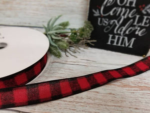 1.5 inch wide red and black buffalo plaid wired ribbon. Buffalo check wired ribbon. Flannel Ribbon. Use in wreaths, garlands, bows, swags, and home decor. Designer DIY carries ribbon, mesh, signs, home decor and other craft supplies.