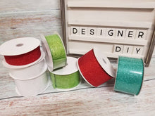 Load image into Gallery viewer, 1.5 inch and 2.5 inch glitter wired ribbon. Use in wreaths, garlands, bows, swags, and home decor. Designer DIY carries ribbon, mesh, signs, home decor and other craft supplies.