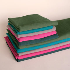 Stack of our Bamboo & Cotton Stretch Fleece and 2x2 Ribbing