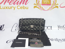 Load image into Gallery viewer, Authentic Chanel east west chain clutch in black caviar silver hardware