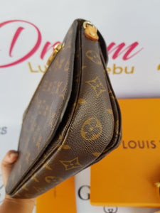 Authentic Louis Vuitton Metis in Monogram Canvas buy and sell