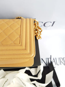 Unused Chanel le boy in small size caviar leather