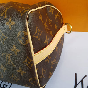Louis Vuitton Speedy 25 Bandouliere Monogram terms layaway