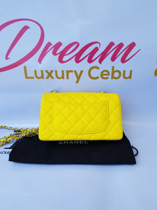 Authentic Chanel Mini Flap Caviar in Yellow pawn hero