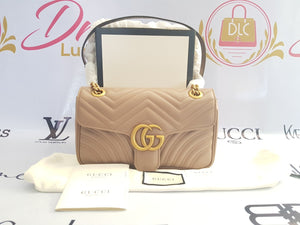 Brand new Authentic Gucci marmont flap in nude beige in antique gold Hardware