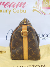 Load image into Gallery viewer, Authentic Chanel bandouliere 25 monogram canvas where to sell