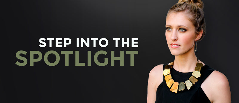 Step Into The Spotlight Model wearing large necklace facing towards the left Betty James Jewelry