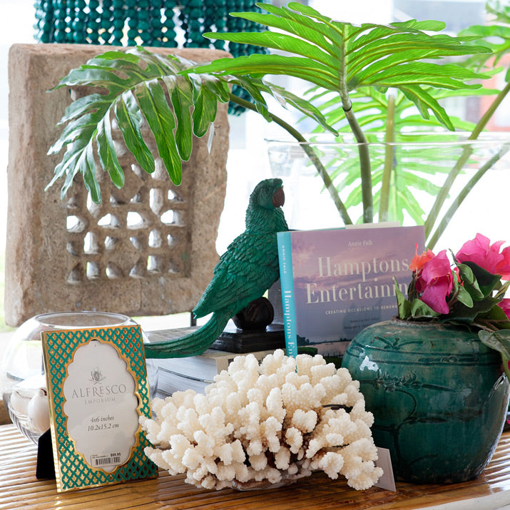 Tropical vignette filled with green and pink.