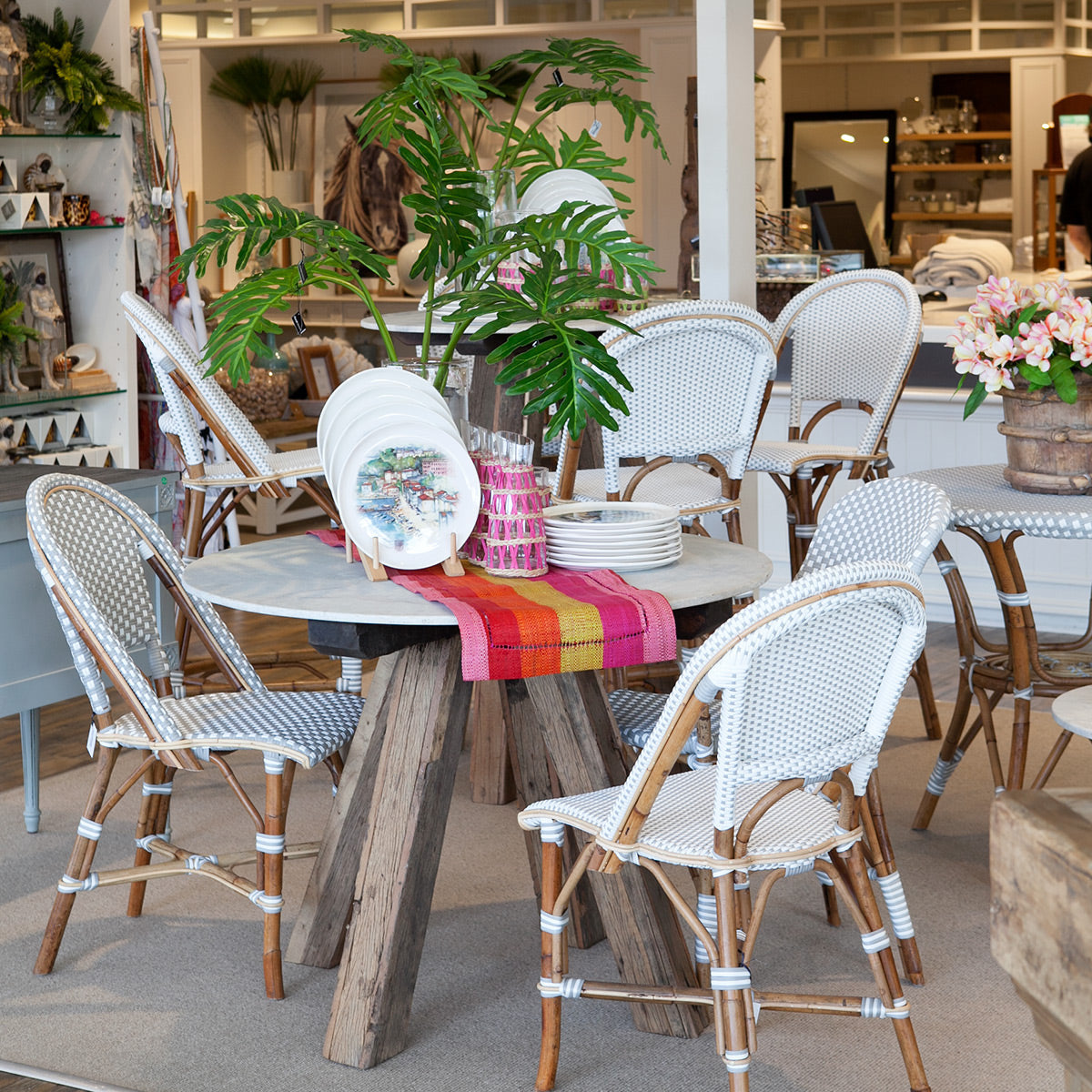 Marble dining tables and St Tropez chairs.