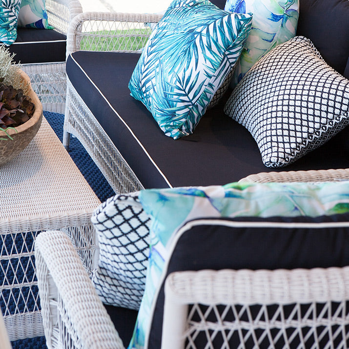 Outdoor lounge in navy and white.