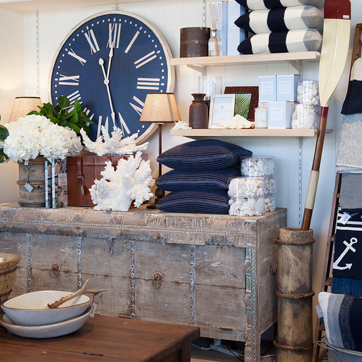Giant navy clock, indian trunk, navy cushions and oars in timber containers.
