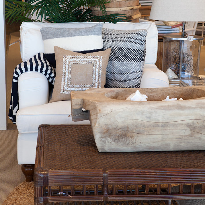 Nantucket armchair white with brown rattan coffee table.