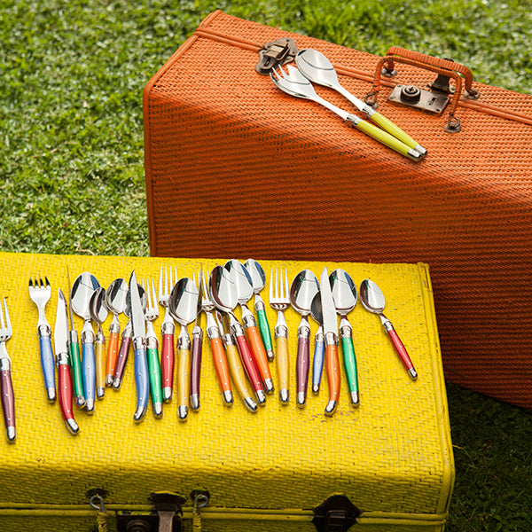 Bright cutlery on rattan trunks.