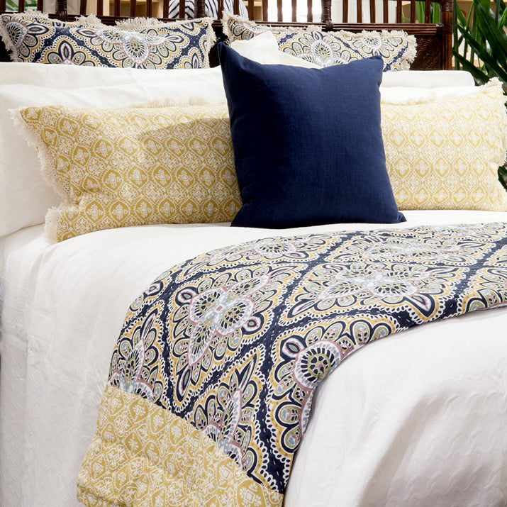 Bed with carnation hand block print bedding.