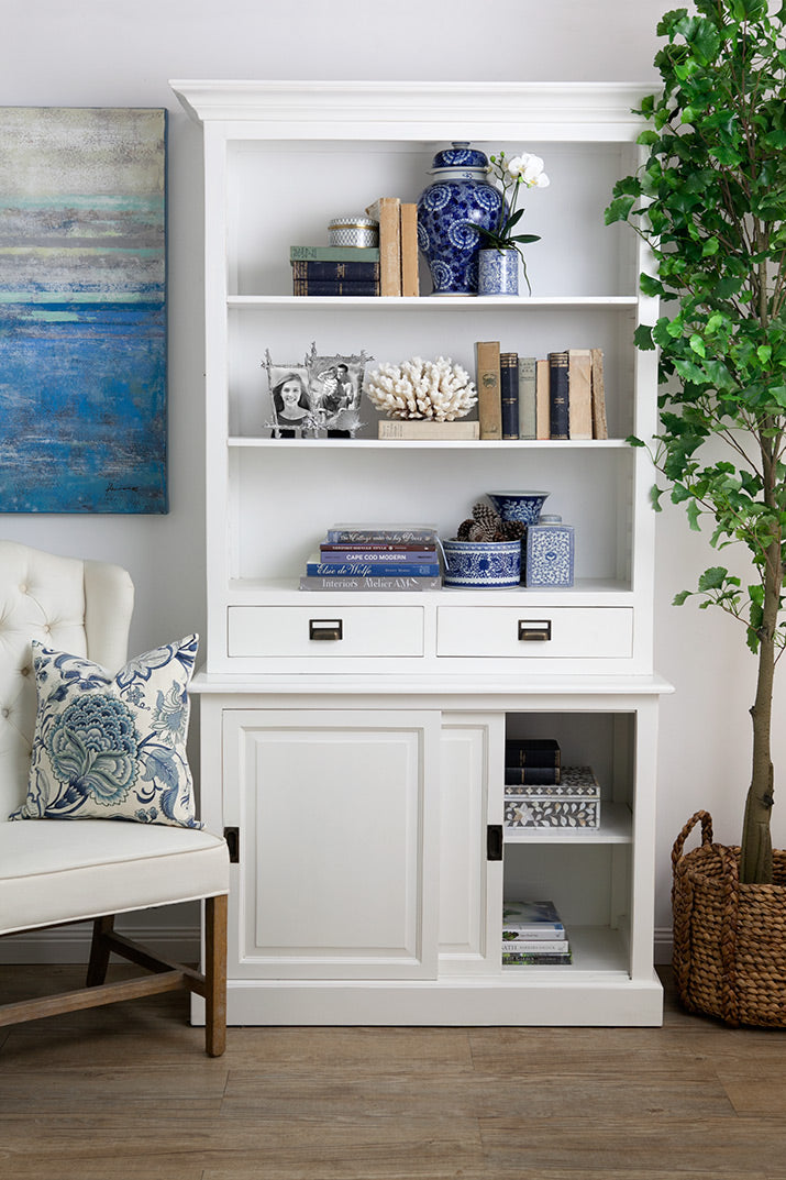 White bookcase styled with blue and white accents.