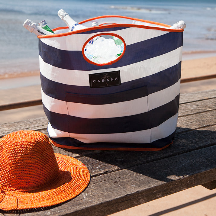 Navy white stripe with orange border Cabana Bag.