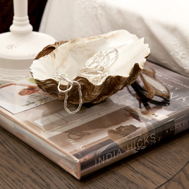 Clam on bedside table for jewellery storage.
