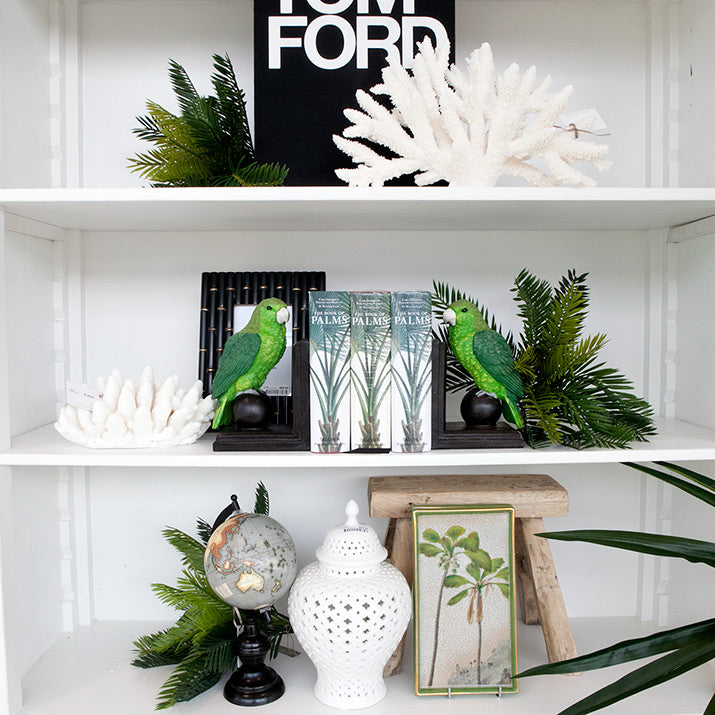 White hutch styled with green accents.