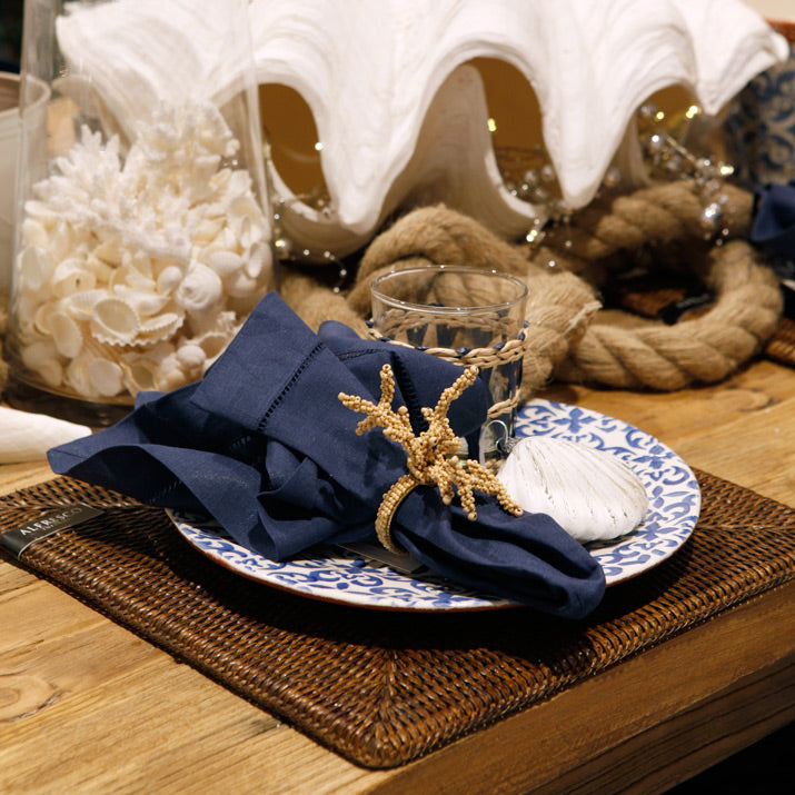 Blue and white coastal table close up.